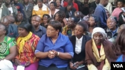 Zimbabwe People First leader Joice Mujuru and Victor Matemadanda (sitting behind Mujuru) attended Douglas Mahiya's court case in Harare on Monday.
