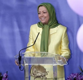 Mariam Rajavi, leader of the Council of Resistance of Iran (NCRI), speaks to supporters at a gathering in Auvers-sur-Oise, near Paris, France, July 17, 2010
