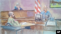 A courtroom sketch shows defense witness Stephen Bennett (R) testifying as Major Nidal Malik Hasan (L) looks on during court-martial of Hasan, accused of killing 13 people during the 2009 shooting rampage at Fort Hood, Texas, Aug. 20, 2013.