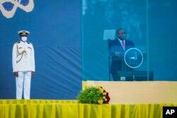 Kenya's President Uhuru Kenyatta speaks behind bulletproof glass in the capital Addis Ababa, Ethiopia, Oct. 4, 2021.