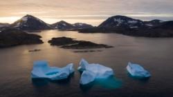In this Aug. 16, 2019, file photo, large icebergs float away as the sun rises near Kulusuk, Greenland. (AP Photo/Felipe Dana, File)