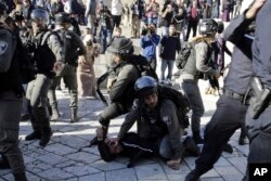 Israeli police officers detain a Palestinian during a protest against U.S. President Donald Trump's decision to recognize Jerusalem as the capital of Israel outside Damascus Gate in Jerusalem's Old City, Dec. 8, 2017.
