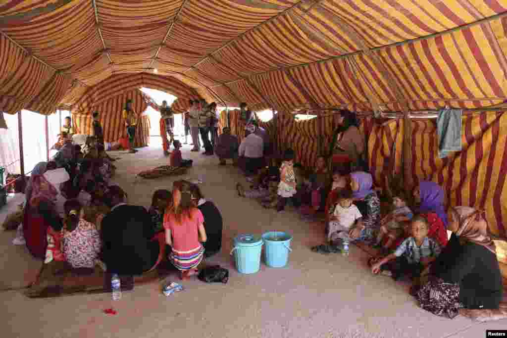 Displaced people from the minority Yazidi sect take refuge at Dohuk province, Aug. 7, 2014.