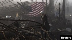 En Queens, Nueva York, aún están las huellas de 'Sandy'. El pavoroso incendio consumo decenas de viviendas.