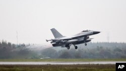FILE - One of the seven Danish F-16 fighter jets takes off from military airport Flyvestation Skrydstrup in Jutland, Denmark.