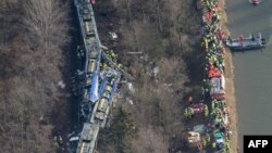 Aerial view shows firefighters and emergency doctors working at the site of a train accident near Bad Aibling, southern Germany,Feb. 9, 2016.
