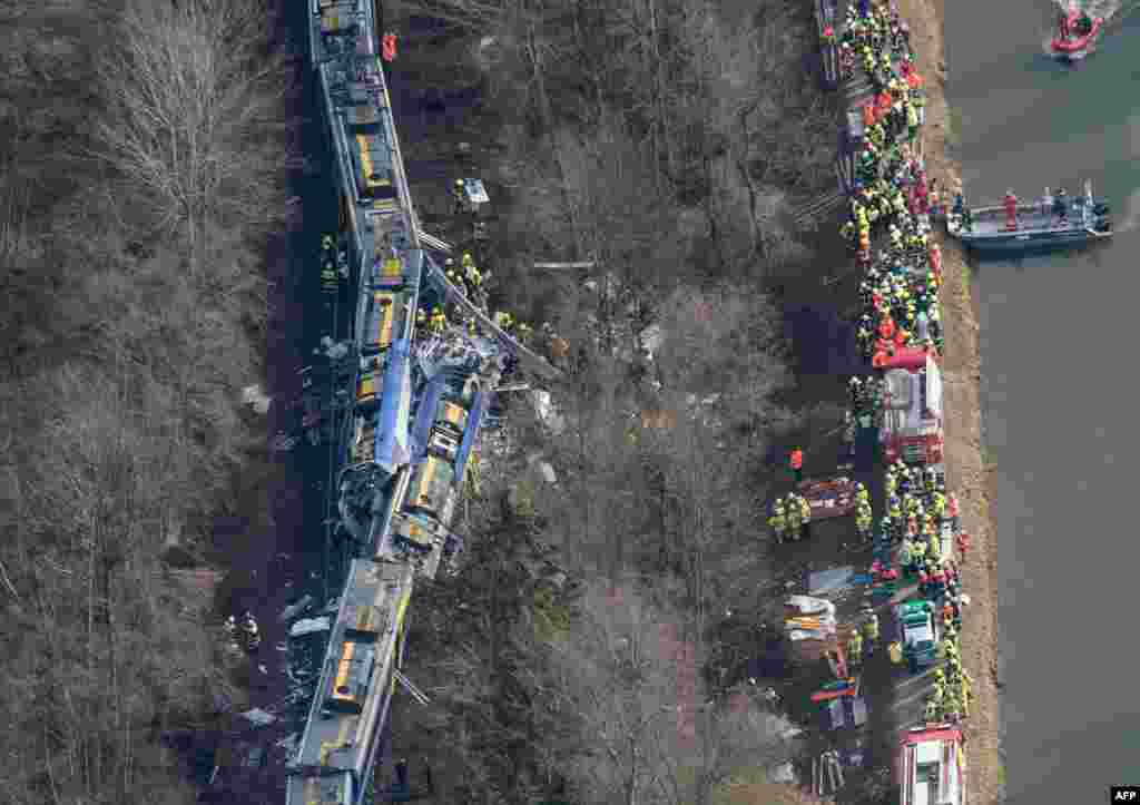 An aerial view shows firefighters and emergency personnel working at the site of a train accident near Bad Aibling, southern Germany. Two Meridian commuter trains operated by Transdev collided head-on near Bad Aibling, around 60 kilometers (40 miles) southeast of Munich, killing at least nine people and injuring close to 100, police said. The cause of the accident was not immediately clear.