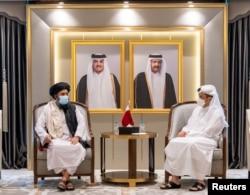 Qatar's Deputy Prime Minister and Minister of Foreign Affairs Mohammed bin Abdulrahman Al Thani meets with Mullah Abdul Ghani Baradar, head of the Taliban's political bureau, in Doha, Qatar, August 17, 2021.