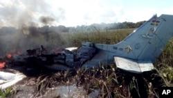 The remains of an aircraft from the Bolivian Air Force burn after crashing near Trinidad, Bolivia, May 2, 2020.