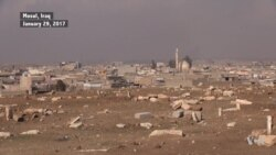 Mosul Residents Repair IS-desecrated Graves