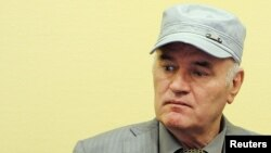 FILE - Former Bosnian Serb commander Ratko Mladic appears in court at the International Criminal Tribunal for the former Yugoslavia (ICTY) in the Hague, Netherlands, June 3, 2011.