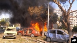 На месте взрыва в центре Дамаска. 21 февраля 2013 г.