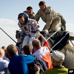 Simpson's wife, astronaut Cady Coleman, after returning from the International Space Station in May 2011.