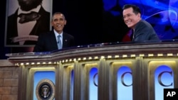 """President Barack Obama talks with Stephen Colbert of """"The Colbert Report"""" during a taping of The Colbert Report program in Lisner Auditorium at George Washington University in Washington, Dec. 8, 2014."""