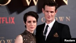 """FILE - Actors Claire Foy, who plays Queen Elizabeth II, and Matt Smith, who plays Philip Duke of Edinburgh, attend the premiere of """"The Crown"""" Season 2 in London, Nov. 21, 2017."""