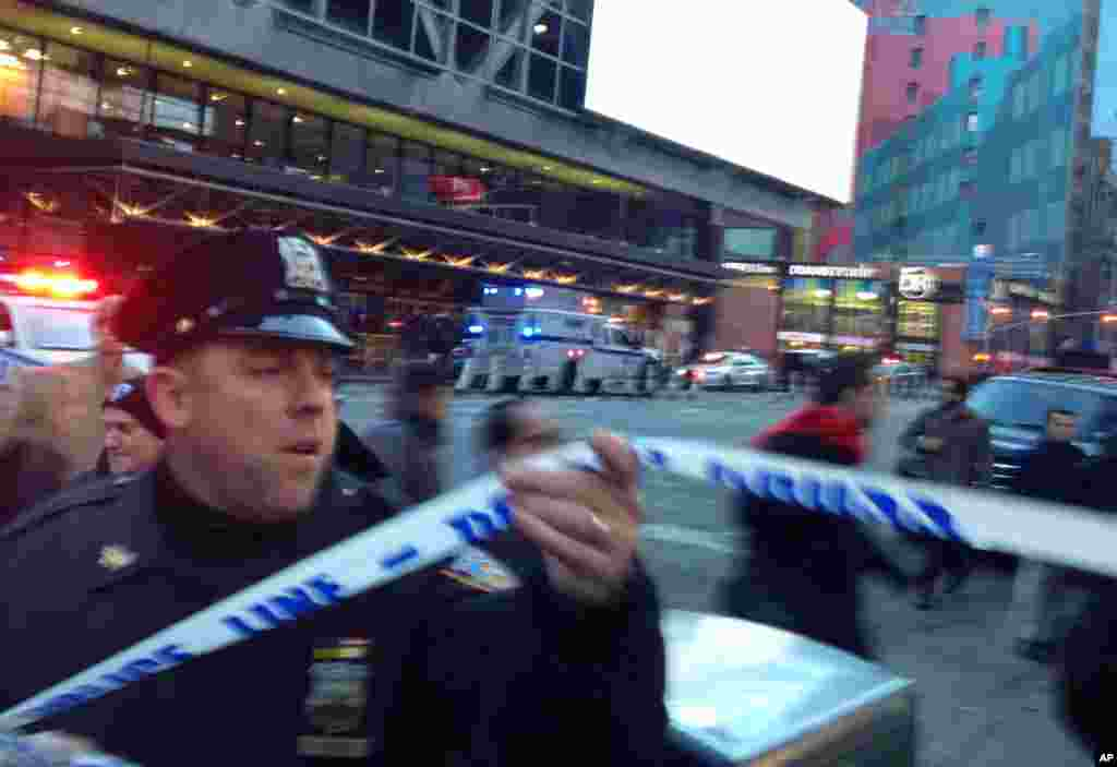 Police respond to a report of an explosion near Times Square on Dec. 11, 2017, in New York.