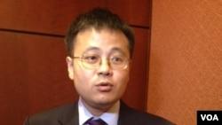 《中國聚焦》雜誌的資深研究員丁力