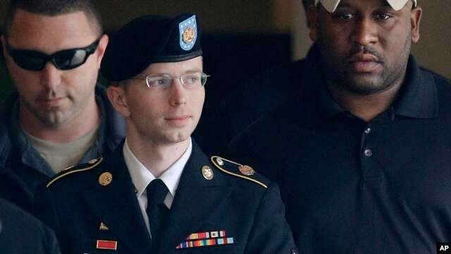 Army Pfc. Bradley Manning is escorted to a security vehicle outside a courthouse in Fort Meade, Md., Aug. 20, 2013, after a hearing in his court martial.