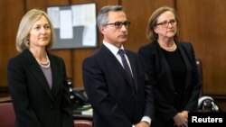 Georges Dirani (C), general counsel for BNP Paribas, appears with his lawyers in New York state court, June 30, 2014. The French bank pleaded guilty to violating U.S. sanctions laws.