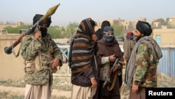 FILE - A group of Taliban fighters are seen in Ghazni province, Afghanistan, April 18, 2015.