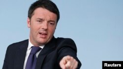 Italy's Prime Minister Matteo Renzi gestures during a news conference at Chigi Palace in Rome, March 31, 2014.