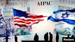 Workers prepare the stage at the American Israel Public Affairs Committee (AIPAC) policy conference in Washington.