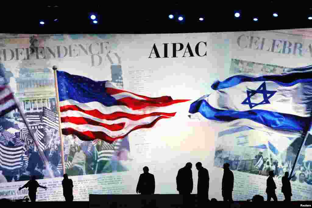 Workers prepare the stage at the American Israel Public Affairs Committee (AIPAC) policy conference in Washington, March 2, 2015.