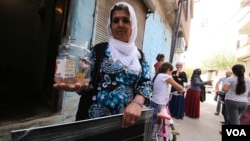 Fatma Oren's family did not forget to take their goldfish when they were among those forced to leave Sur's Ali Pasa neighborhood, which was among several that were damaged in clashes. Many don't want to leave and say the government compensation is too little. (M. Bozarslan/VOA)