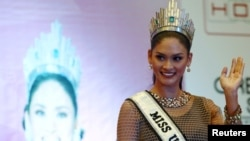FILE - Miss Universe 2015 Pia Wurtzbach waves during a news conference at a hotel in Quezon city, metro Manila, Jan. 24, 2016, after her return to the Philippines.