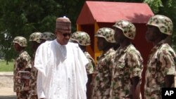 Nigerian President Muhammadu Buhari reviews troops in Maiduguri on Oct. 1, 2017.