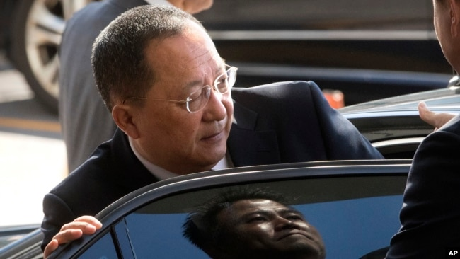FILE - North Korean Foreign Minister Ri Yong Ho gets into a car at Beijing Capital International Airport in Beijing, China, Sept. 19, 2017.