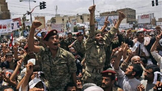 Yemeni army officers lifted by anti-government protestors gesture as they join a demonstration demanding the resignation of of Yemeni President Ali Abdullah Saleh, in Sanaa, Yemen, April 24, 2011