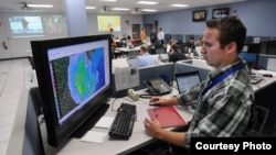 A Walmart meteorologist at his station in the disaster operations center checking on Sandy's progress (Walmart)