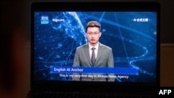 This photo illustration shows a man watching an artificial intelligence (AI) news anchor from a state-controlled news broadcaster, on his computer in Beijing, Nov. 9, 2018.