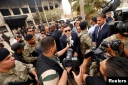 Libyan Prime Minister Fayez al-Sarraj talks to media in front of the electoral commission building after the suicide attack in Tripoli, Libya, May 2, 2018.