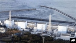 Fukushima Daiichi power plant's Unit 1 is seen in Okumamachi, Fukushima prefecture, Japan, Friday, March 11, 2011