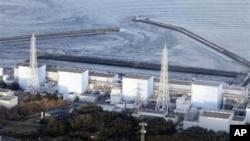 Fukushima Daiichi power plant's Unit 1 is seen in Okumamachi, Fukushima prefecture, Japan, Friday, March 11, 2011