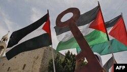 Những người Palestine tham gia cuộc biểu tình đánh dấu năm thứ 63 ngày họ gọi là 'Ðại họa' ở quảng trường Máng Cỏ trong thành phố Bethlehem ở vùng bờ Tây
