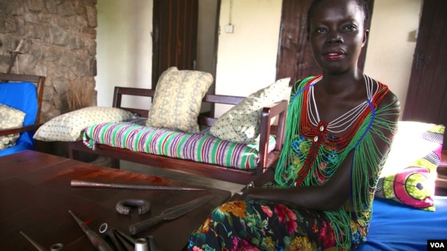 South Sudanese fashion designer and anthropologist Akuja de Garang hopes to promote the country's bullet blacksmiths and others using shell casings to make spears, pipes and jewelry before such skills are lost, Oct. 2013.  (H. McNeish/for VOA)