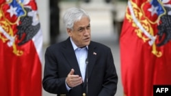 El presidente chileno, Sebastian Piñera, se dirige a la nación en Santiago, el 26 de octubre de 2019. (Foto de Pedro López / AFP).