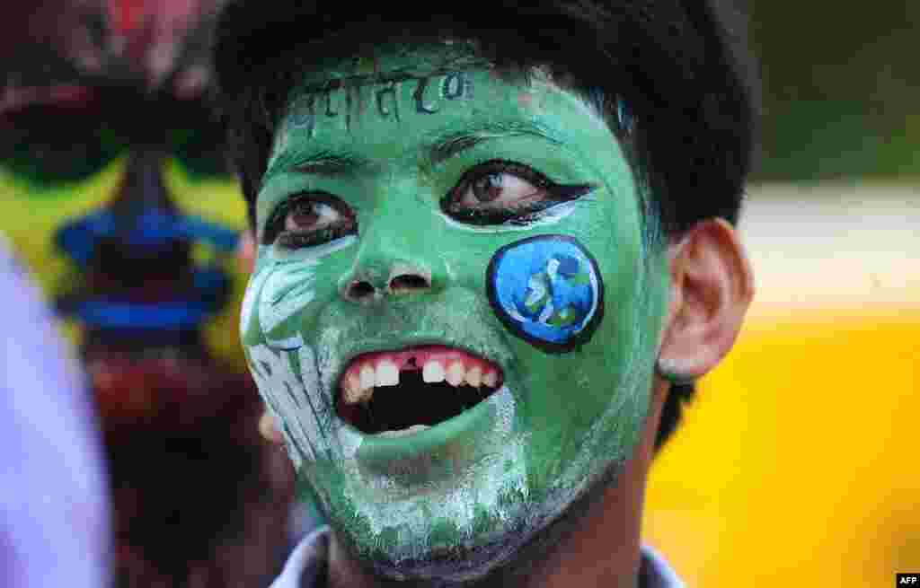 An Indian student wears facepaint during an awareness rally to mark World Environmental Day in Allahabad.