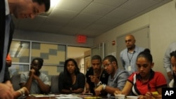 New York City students play Ne$t Egg at the city's Department of Youth and Community Development.