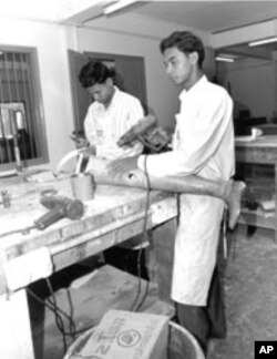 Technicians in Cambodia manufacture prosthetic leg for use by a landmine survivor