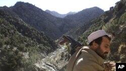 FILE - A soldier patrols the White Mountains near Tora Bora, Afghanistan, Dec. 18, 2001.