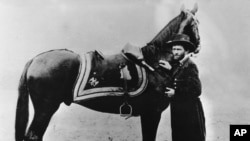 Gen. Ulysses S. Grant, commander of the Union Army during the American Civil War, poses with his horse in this undated photo at an unknown location. (AP Photo)
