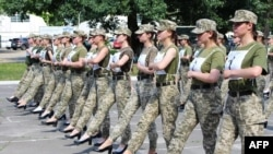 A handout photograph taken and released by the Ukrainian Defence ministry press-service on July 2, 2021 shows the Ukrainian female soldiers wearing heels while taking part in the the military parade rehearsal in Kyiv.