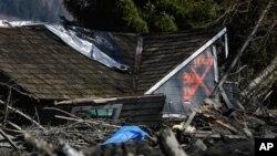 Rumah yang hancur karena tanah longsor di dekat Oso, Washington (23/3).