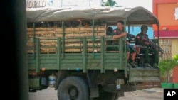 FILE - Myanmar troops and police patrol in Kayah state, eastern Myanmar, May 23, 2021. The U.N. rights office has expressed concern over recent military deployments in Chin state, Central Sagaing and Magway regions.