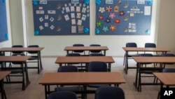 FILE - Image of an empty classroom at a Christian school. Alabama's reigning Teacher of the Year says she resigned after state officials told her she's unqualified to teach in her fifth-grade classroom.