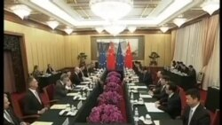 VOA连线: 中欧领袖会议开启投资协定谈判; 西班牙对前中国领导人发出拘捕令